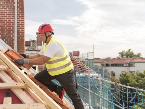 Urban roofers roofer laying roof tiles construction worker wearing hard hat